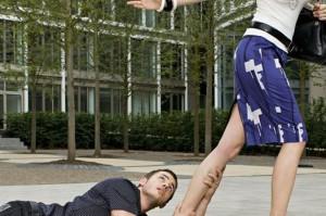 man stopping her girlfriend